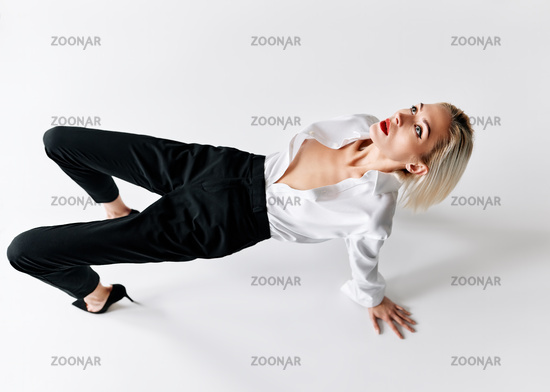 Style beautiful blonde woman posing on the floor