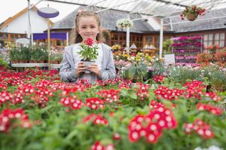 Child holding flower pot