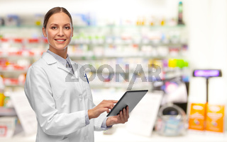 female doctor with tablet pc at pharmacy