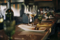 Wine bottle and glasses on the table, against the background of wine dinner.