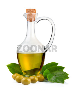 Bottle of olive oil and green leaves isolated on white