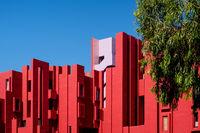 The modern apartment complex 'La Muralla Roja' by architect Ricardo Bofill in Calpe, Spain