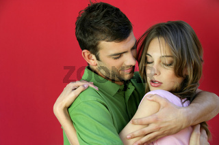 Passionate couple hugging