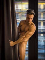 Totally Naked Muscular Young Man Covering With Drapes