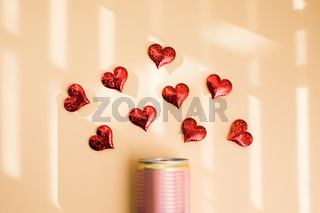 Portion of alcohol and red hearts on beige