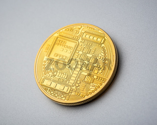 Back side of Bitcoin coin on brushed aluminium background