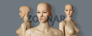 group of 3 naked and bald store window mannequins or display dummies with realistic faces