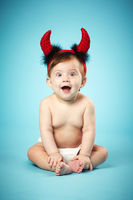 little funny baby with devil horns