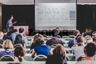 Audience in lecture hall participating at scientific conference.