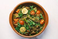 Seasonal vegan mediterranean pasta pot with asparagus, zucchine, tomato, champigon and arugula