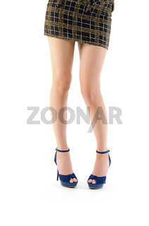 legs in blue shoes and brown skirt isolated