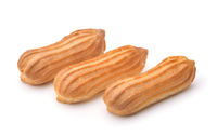 Three fresh baked eclairs isolated on white
