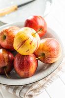 Fresh autumn apples on plate.
