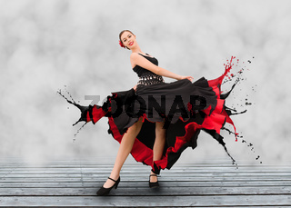 Flamenco dancer with dress turning to paint splashes