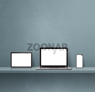 Laptop, mobile phone and digital tablet pc on grey wall shelf. Square background
