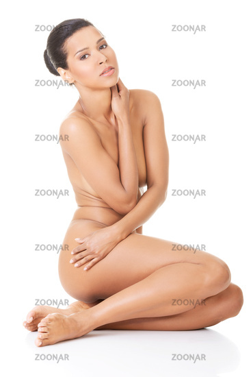 Sexy fit naked woman with healthy clean skin sitting