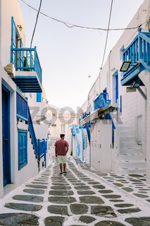 Mykonos Greece, Young man at the Streets of old town Mikonos during vacation in Greece, Little Venice Mykonos Greece