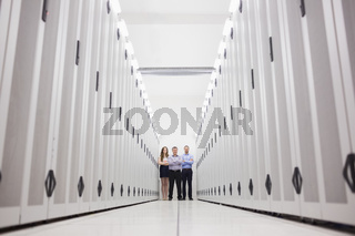 Three technicians standing at end of hallway