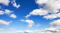 Sky background with fluffy clouds