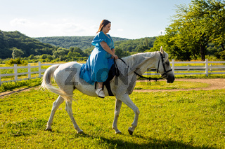 The woman restores her mental health by riding a horse
