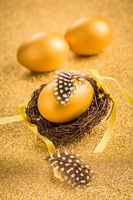 Golden egss on golden background for Easter