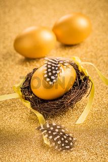 Golden egss on golden background for Easter