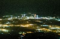 Abstract night view of charlotte nc downtown from airplane