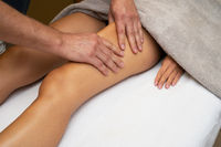 Woman getting legs massage in spa salon