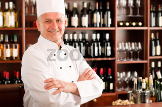 Chef cook confident professional posing restaurant