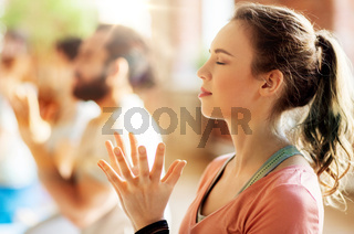 woman with group meditating at yoga studio