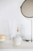 Cosmetic products and mirror on table
