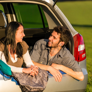 Camping young couple lying car summer sunset
