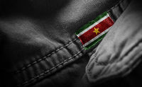 Tag on dark clothing in the form of the flag of the Suriname