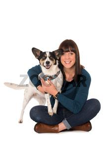 Young woman hugs her dog