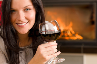 Winter home fireplace woman glass red wine