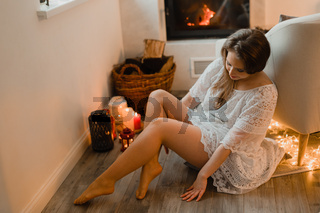 the beautiful young girl enjoys a moment in a cozy room