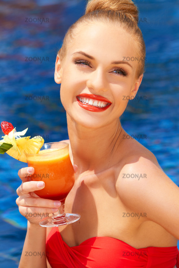 Beautiful woman with tropical cocktail