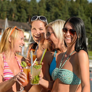 Young women in bikini partying with cocktails