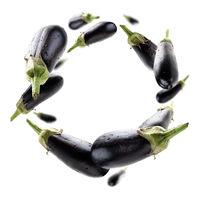 Ripe eggplants levitate on a white background