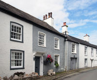 street of old picturesque houses in the village of cartmel in cumbria