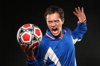 football player screaming at ball