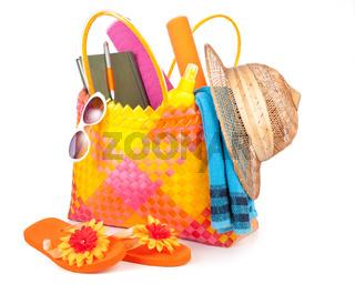 Beach bag with items.