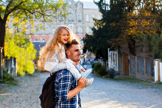 dad and daughter have a great time during travel
