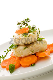 Cod over carrots isolated