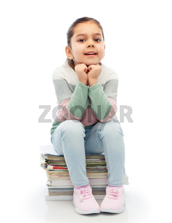smiling girl with magazines sorting paper waste