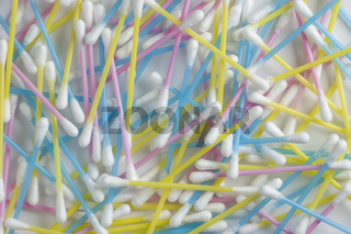 Strewn colorful plastic Q-tips / cotton swabs