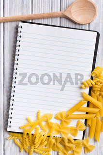 blank recipe book with various pasta