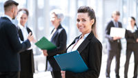 Business woman in front of colleagues