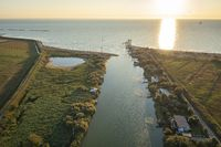 Awesome drone shot of fishing huts in adriatic coast