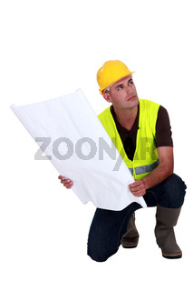 construction supervisor holding a blueprint